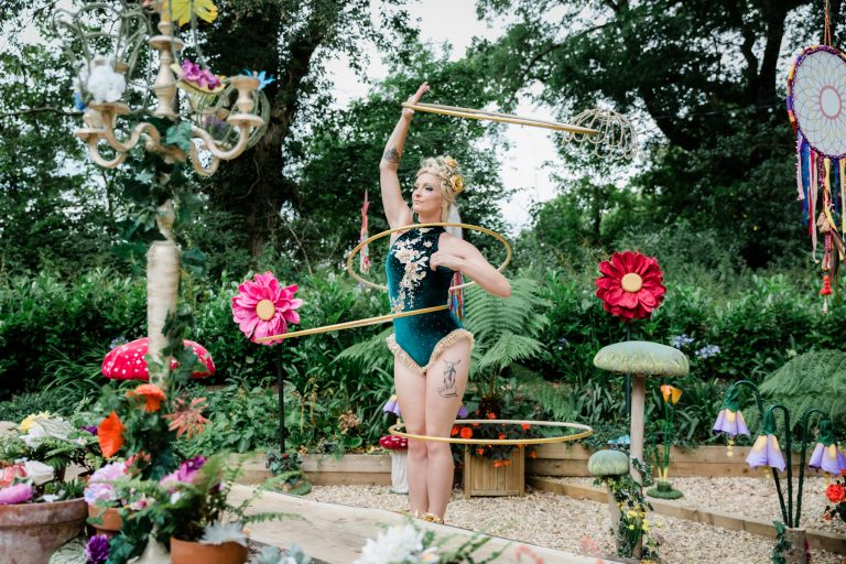 Pixie hula hoop artist for hire UK and internationally. Hula shows and walkabout act.