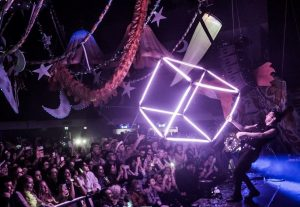Cube over crowd